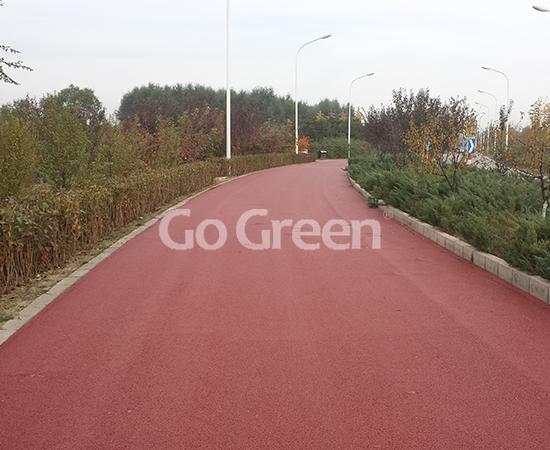 Proyecto de asfalto coloreado de mezcla cálida de color rojo