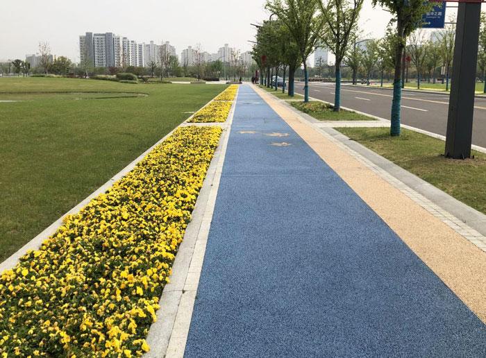 Material de pavimento de color